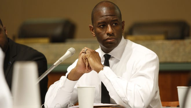 Mayor Andrew Gillum listens to proceedings during Wednesday's CRA meeting at City Hall.