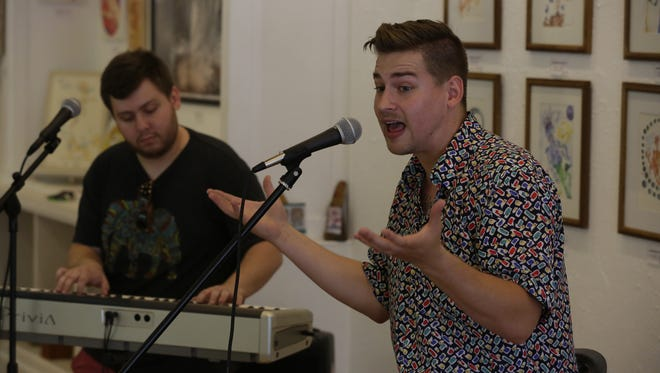 Keag, a hip-hop artist from Oshkosh, rehearses songs with Dylan Finley at Jambalaya Arts Inc. in Oshkosh. He will be performing in the Main Street Music Festival July 28 at Peabody's Ale House.