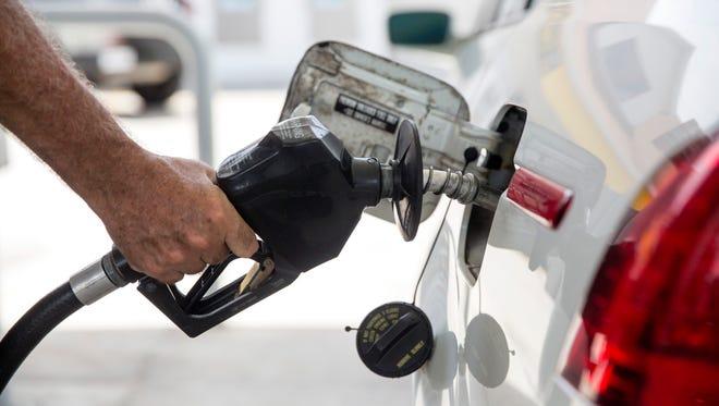 Mark Cohen pumps gas at the Sunoco on the corner of U.S. 41 and Bonita Beach Road in Bonita Springs on Monday, July 24, 2017. Regular gas was $2.19 per gallon.