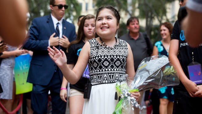 Lauren Major, 12, waves to the hundreds of friends, fans and supporters who came to greet her for her grand entrance into the Sugden Theatre prior to her sold-out concert performance Sunday, October 16, 2016, in Naples. Lauren was diagnosed with Crohn's disease at an early age and with the help of the Make-A-Wish Foundation of Southern Florida her wish, to become a singer, came true.