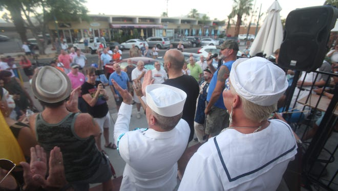 Members of the community attend a rally on Arenas Road in Palm Springs in support of transgender members of the U.S. military.