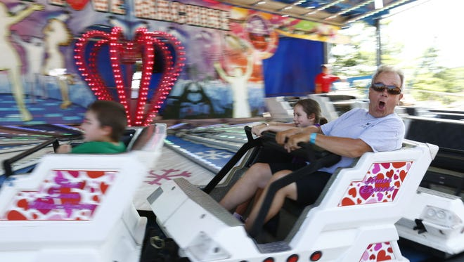 People enjoy riding a Wisconsin Valley Fair's ride in 2016 at the Marathon Park in Wausau.
