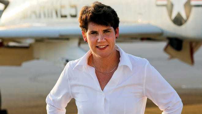 This undated photo provided by her congressional campaign, shows retired Lt. Col. Amy McGrath, a former fighter pilot, who announced Tuesday, Aug. 1, 2017, that she will seek the Democratic nomination for Congress in Kentucky's 6th District.