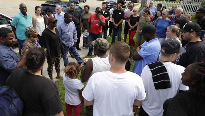 Family, friends, neighbors and community members held a justice vigil on Saturday for Isaiah Tucker, who was shot and killed by an Oshkosh police officer on July 31.