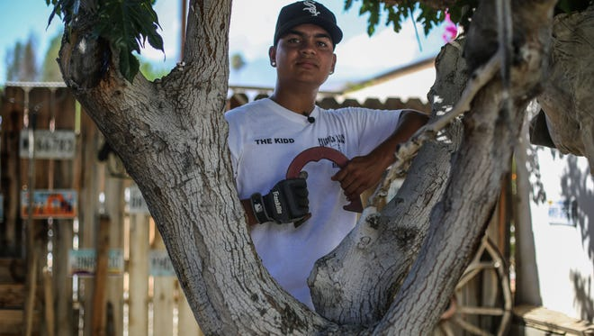 National champion horseshoe player, Aaron Tarango, in his backyard where he practices his sport on Friday, August 4, 2017 in La Quinta.