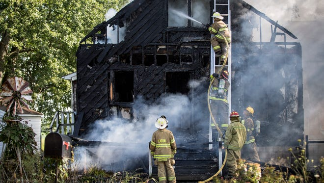 Firefighters from several departments try to tackle a fully involved blaze Aug. 9 at the house on Delaware County Road 1200-N, near County Road 175.