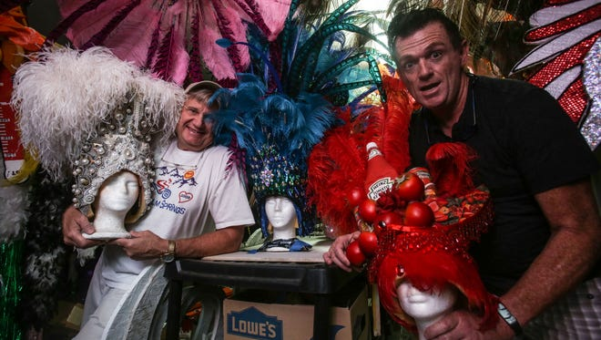 Drag performer Pinkie Meringue Shimmer, aka Larry Edwards, right, and husband, and costume maker, Kevin Baar, with some of their favorite headdresses on July 26, 2017 in Palm Springs.