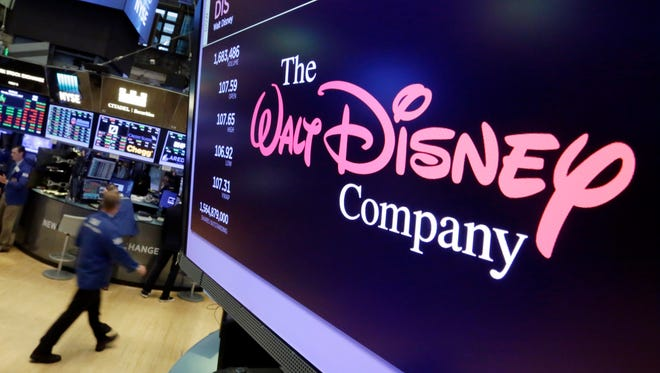 The Walt Disney Co. logo on a screen above the floor of the New York Stock Exchange on Aug. 7, 2017. CEO Robert Iger says the company will begin its own streaming service for Disney and Pixar movies in 2019.
