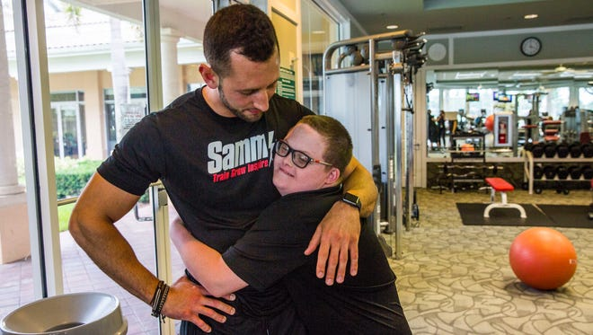 Parker Seward, 13, gives a mid-workout hug to personal trainer Sammy Callari at his community gym in North Naples on Thursday, Aug. 10, 2017. The pair have been working out together for a year and have developed a brother-like relationship. Callari works to spread awareness about the abilities, not disabilities, of those with Down syndrome.
