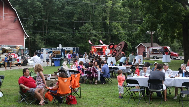 Guests enjoy the food and music at July's Al Fresco Affair at Croft Farm in Cherry Hill.