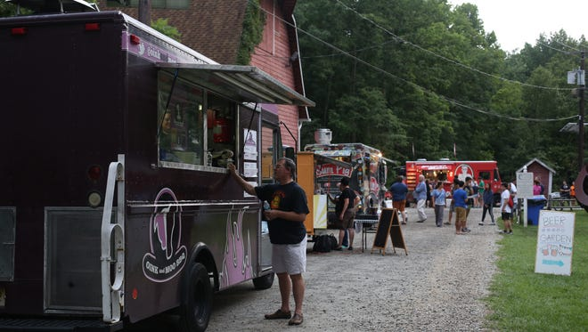 Guests order dinner from Oink and Moo food truck at an Al Fresco Affair at Croft Farm last year.