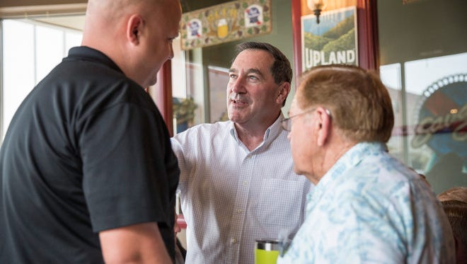 Senator Joe Donnelly talks with members of the public during his re-election tour across Indiana Aug. 21 at Savage's Ale House in downtown Muncie.