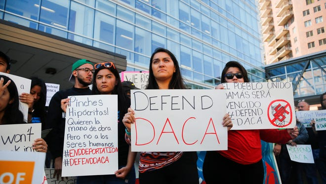 More than 100 gather for a rally supporting immigrants outside the federal building following the suspension of the DACA program Tuesday, Sept. 5, 2017.