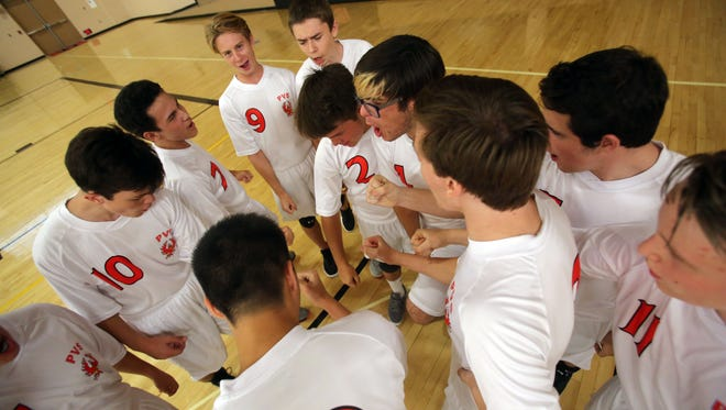 The Palm Valley High School boys volleyball do a group cheer before their first game, played against Victor Valley Christian on Tuesday, September 5, 2017 in Rancho Mirage.