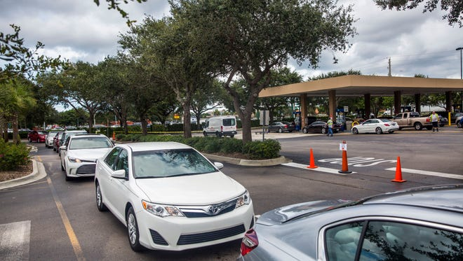 Cars in line for gas at Sam's Club on Immokalee Road on Wednesday, Sept. 6, 2017 in preparation for Hurricane Irma.