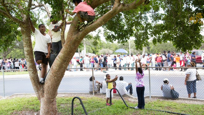 Residents wait patiently outside of Lely High School, designated as a hurricane shelter, to be checked into the school Friday, September 8, 2017 in Naples. The school can hold, if need be, almost 1,300 people.