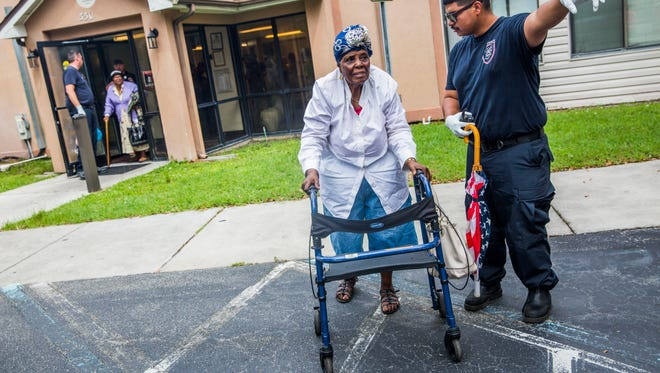 Milela Cineas is evacuated from Cypress Run, an affordable housing retirement home, in Immokalee as Hurricane Irma approaches on Saturday Sept. 9, 2017.