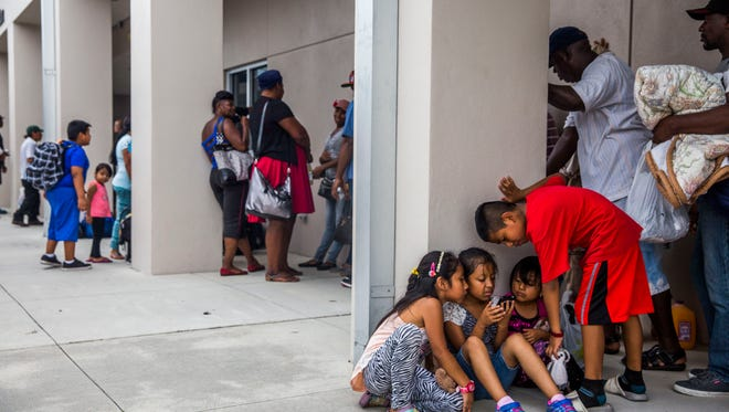 Families wait in line for shelter at Pinecrest Elementary School in Immokalee as Hurricane Irma approaches on Saturday Sept. 9, 2017.