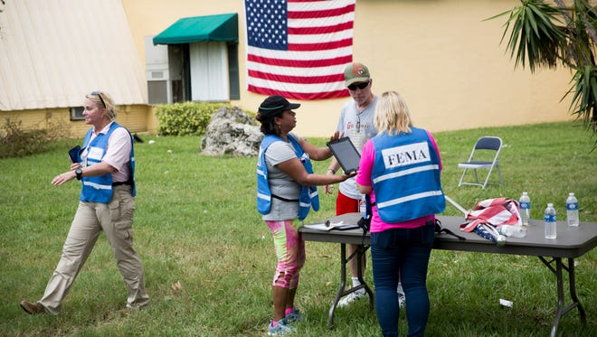 Workers with FEMA work to register area residents at Naples Estates, a mobile home community off of Rattlesnake Hammock Road, Thursday, September 14, 2017 in Naples, Fla.
