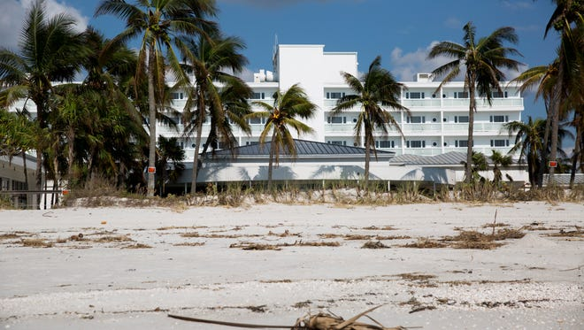 Debris litters the beach in from of the Naples Beach Hotel & Golf Club Friday, September 15, 2017 in Naples.