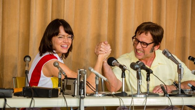Billie Jean King (Emma Stone) and Bobby Riggs (Steve Carell) grapple for bragging rights in 'Battle of the Sexes.'
