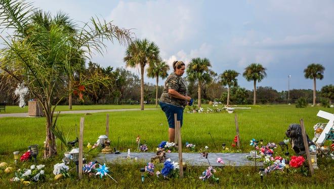 Noemi Trujillo at her sons grave at Lake Trafford Memorial Gardens on Wednesday, Sept. 20, 2017.