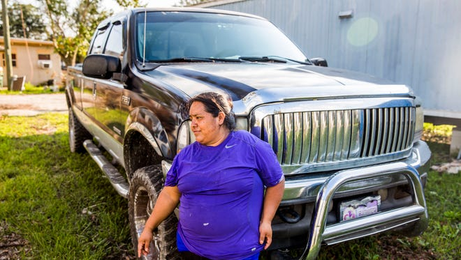 Maura Diaz takes a moment for herself outside her damaged Immokalee trailer on Thursday, Sept. 21, 2017.