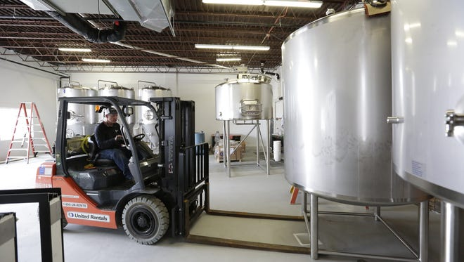 Marty Braatz of Quality Tank Solutions unloads brewing tanks Tuesday, Sept. 26, 2017, at Fifth Ward Brewing Co. in Oshkosh. The brewery and taproom will produce specialty beers after a more than $1 million remodel of the 7,500-square-foot building at 1009 S. Main St. Owners Zach Clark and Ian Wenger hope to open the business in early November. Plans include a story-high window revealing brewing operations, metal latticework bearing hop plants and an outdoor beer garden in back.