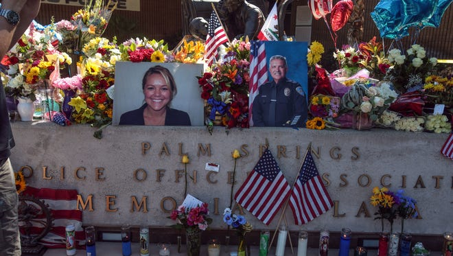 Flowers are piled onto the memorial in front of the Palm Springs Police Department on Oct. 9, a day after officers Lesley Zerebny and Jose 'Gil' Vega were killed.