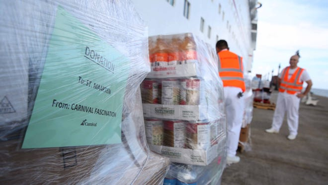 Relief supplies for hurricane-ravaged St. Maarten are unloaded from a Carnival cruise ship in the nearby island of St. Kitts.