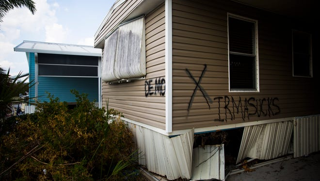 """A few trailer homes are marked with the word """"demo"""" in Fisherman's Cove on Thursday, September 21, 2017 in Everglades City."""