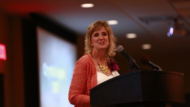 Crystal Apple Awards recipient Debbie Heidmann, of Auburndale Elementary School, makes a speech during the banquet Wednesday night, October 4, 2017, at Hotel Marshfield in Marshfield, Wis. T'xer Zhon Kha/USA TODAY NETWORK-Wisconsin