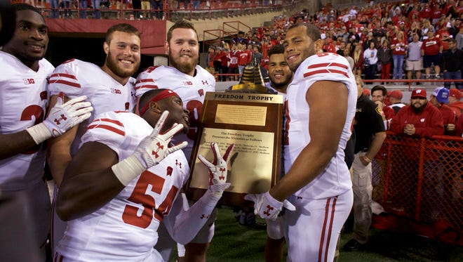 Wisconsin Badgers players celebrate after defeating the Nebraska Cornhuskers.