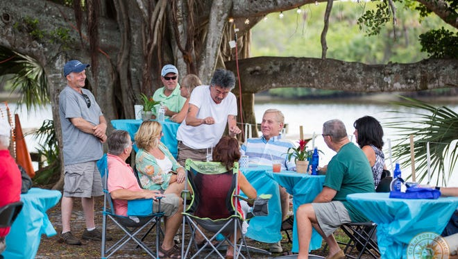 Visitors relax near the St. Lucie River at Port St. Lucie's River Nights.