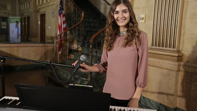 """Franki Moscato performs her song """"Me, Myself, and I"""" at the Oshkosh Northwestern on October 4, 2017."""