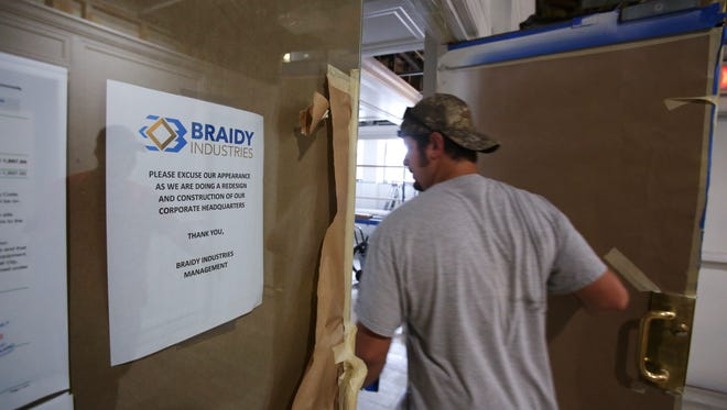 A worker walked into the Braidy Industries corporate headquarters office still under construction inside the Community Trust Bank building in downtown Ashland, Ky.  The company plans to build an alumninum plant in neighboring Greenup County.Oct. 10, 2017