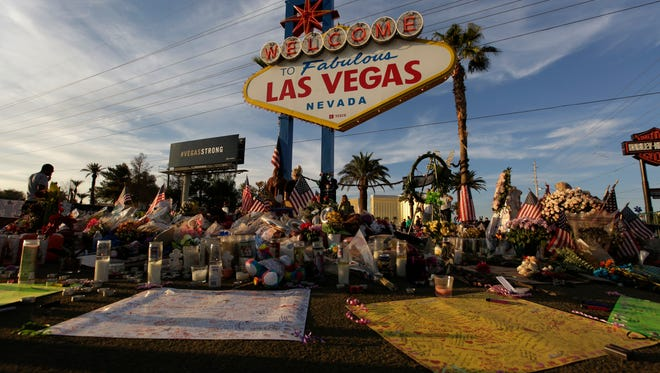People visit a makeshift memorial for victims of the mass shooting in Las Vegas.