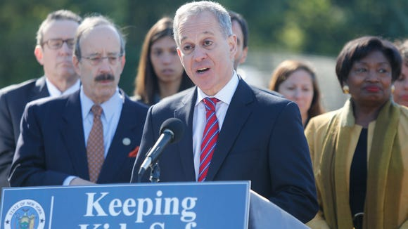 New York Attorney General Eric Schneiderman at a press conference, along with elected officials announcing a proposal to close a loop hole that doesn't track bus drivers who illegally go through a red light in Yonkers on Oct. 17, 2017.