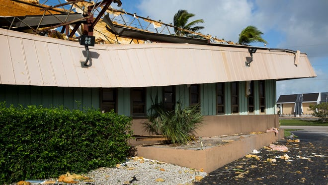 Damage from Hurricane Irma can be seen at the Marco Eagle office on Monday, September 11, 2017 in Marco Island, Fla.