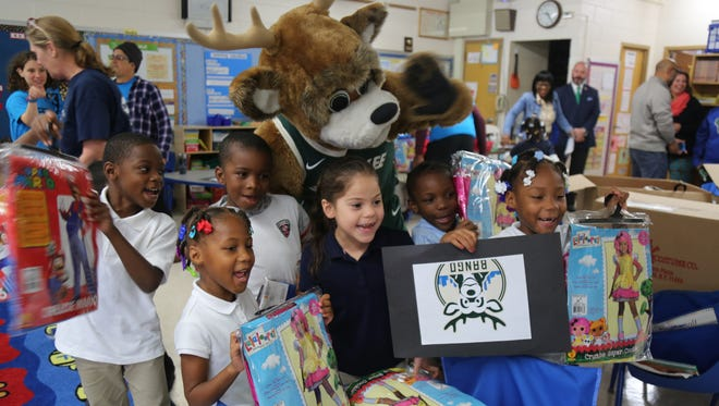 More than 225 Milwaukee children were the recipients of Halloween costumes donated by the Milwaukee Bucks and BuyCostumes.com.