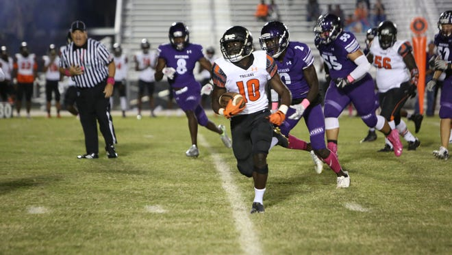Lely's Henderson Francois finds a hole against Cypress Lake.