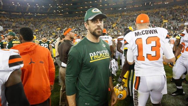 Green Bay Packers quarterback Aaron Rodgers meets with Cleveland Browns players after their preseason game against the Cleveland Browns on  Aug. 12, 2016.