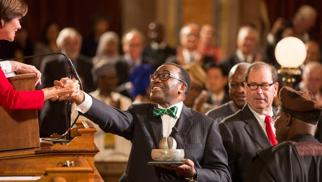 2017 World Food Prize Laureate Akinwumi A. Adesina shakes hands with Governor Kim Reynolds after receiving his award Thursday, Oct. 19, 2017.