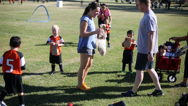 Desert Flipper TV hosts Eric and Lindsey Bennett hand out bag lunches to their son's soccer team at Demuth Park in Palm Springs on October 28, 2017.