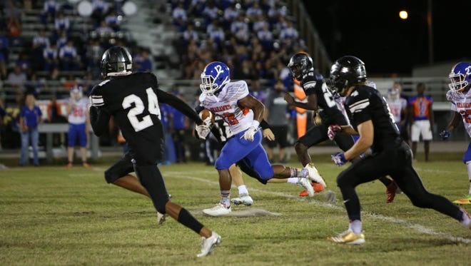 Scenes from the Cape Coral at Mariner high school football game on Nov. 3. Rickey Anderson breaks through for a big gain.