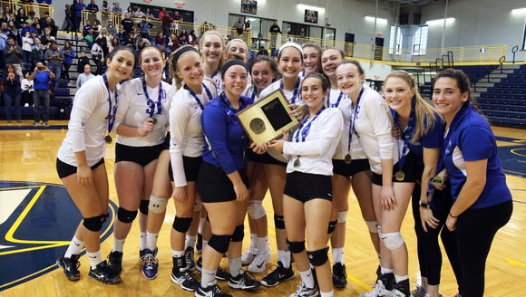 The Haldane girls volleyball team holds its Section