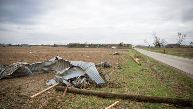 Debris from farms litter the fields all over East 300 North near Portland on Nov. 6 after a tornado slammed into the area on the prior day. The storm system that spawned a tornado in Jay County also affected Muncie, Eaton and other communities in East Central Indiana.