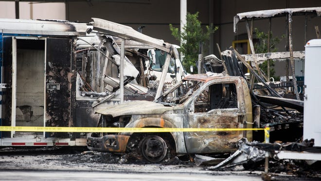 Damaged vehicles sit in the parking lot next to Coastal Beverage on Progress Avenue on Monday, Nov. 6, 2017. Three semitrailers caught fire early Monday. No one was injured.