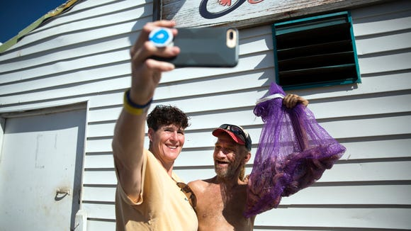 Pat Muller, left, takes a selfie with Scott Cowles, captain of Miss Maddie, on Wednesday, November 8, 2017 near Matanzas Harbor. The Ostego Bay Foundation Marine Science Center tours the shrimp boats on the waterfront on their Working Waterfront Tour.