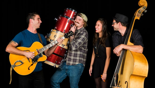 The Woodwork poses for a photo in the Naples Daily News studio on Thursday, Nov. 2, 2017. The folk and jazz-infused indie band is composed of guitarist and vocalist Taylor Freydberg, from left, drummer Mayo Coates, vocalist Christina Ortega, and upright bassist Julio Pintos.